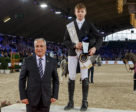 Ireland's Seamus Hughes-Kennedy pictured with FEI President Ingmar de Vos after being crowned the first-ever winner of the FEI Pony Jumping Trophy™ at the series Final in Mechelen, Belgium. Photo by FEI/Dirk Caremans