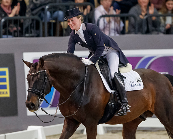 Germany's Helen Langehanenberg, praises her stallion, Damsey FRH, after competing in the seventh leg of the FEI World Cup™ Dressage 2017/2018 Western European League in Neumünster, Germany today where the pair produced the winning score on their last outing before the arrival of her baby. Photo by FEI/Stefan Lafrentz