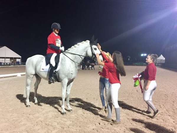 Jacqueline Brooks is given a T-shirt to put on over her tails, and D Niro (aka Goose) is surrounded by Canadian fans at the Adequan Global Dressage Festival.
