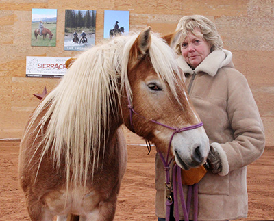 Anne Porteous of Sierra Acres Equine Assisted Healing Centre, with therapy horse Charlie.