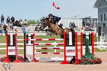 Ireland's Daniel Coyle riding Farona for owner Ariel Grange topped a nine-horse jump-off to win the $35,500 CSI2* Grand Prix, presented by Horseware Ireland, on Sunday, May 20, at the Caledon Equestrian Park in Caledon, ON.