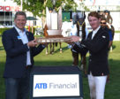 Daniel Coyle (IRL) winner of the ATB Financial Cup raises the trophy with Curtis Stange, Chief Customer Officer, ATB Financial. Photo © Spruce Meadows Media