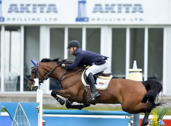 John Perez (COL) & Utopia jump to a win in the AKITA Drilling Cavalry Charge