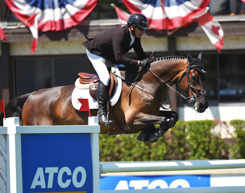 Eric Lamaze guided Chesney, owned by Artisan Farms, to victory in the $35,500 1.45m ATCO Cup on Thursday, July 5, during the CSI5* Spruce Meadows 'North American' tournament in Calgary, AB. Photo by Spruce Meadows Media