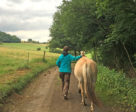 Carolina enjoying a walk with one of her Fjords at my German clinic.