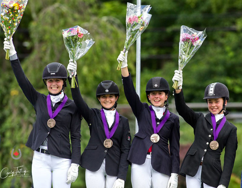 Team Canada Central brought home the bronze medal in the Dressage Junior Rider Team Championship at the 2018 Adequan/FEI North American Youth Championships on Aug. 2 in North Salem, NY. L to R: Jade Buchanan, Brooke Mancusi, Kiara Williams-Brown, Anna Swackhammer Photo © Cealy Tetley - www.tetleyphoto.com