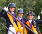 It's a big thumbs up from Jil-Marielle Becks GER (silver), Charlotte Fry GBR (gold) and Lisa Maria Klossinger GER (bronze) after stepping off the Freestyle podium at the FEI European Dressage Championships U25 2018 in Exloo, The Netherlands.