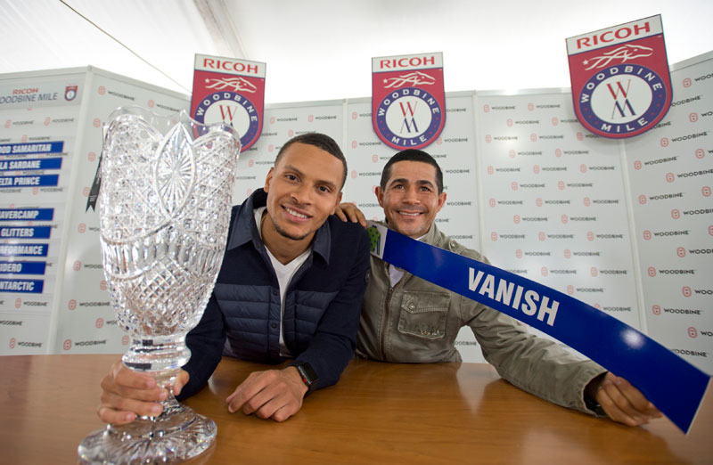 Three-time Olympic sprint medalist Andre De Grasse and jockey Ademar Santos at the Ricoh Woodbine Mile post position draw on Wednesday, Sept. 12 at Woodbine Racetrack. Michael Burns Photo