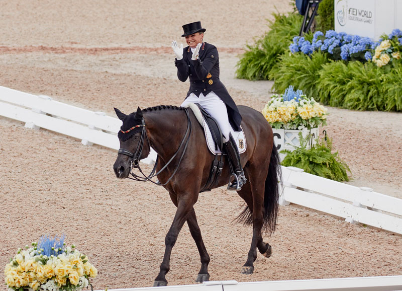 Germany's Dorothee Schneider was well-pleased when slotting into third place individually with Sammy Davis Jr. when Team Dressage got underway at the FEI World Equestrian Games™ Tryon 2018. Photo by FEI/Liz Gregg