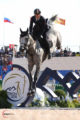 Italy's Lorenzo de Luca leads the individual show jumping competition. Photo by Sportfot