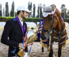 """Thanks mate!"" Nadav Sternbach shows the trophy to Aragon, the borrowed horse who carried him to victory today at the FEI World Jumping Challenge Series Final 2018 in Tashkent (UZB). Photo by FEI/Yong Teck Lim"