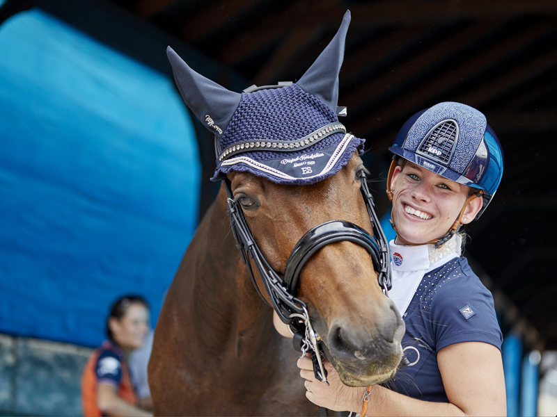 Rixt Van der Horst (NED) with her new horse, Findsley take delight in securing the gold medal in the Adequan© Para Dressage at the FEI World Equestrian Games™ Tryon today, successfully defending her World Championship individual title from Normandy 2014.