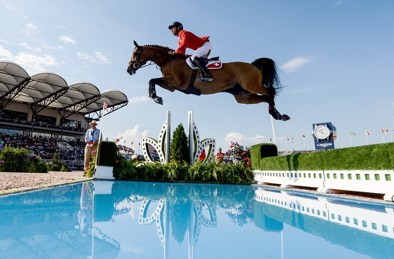 A brilliant round from Steve Guerdat and Bianca put the 2012 Olympic champion and Team Switzerland into pole position as the Bank of America Jumping Championship got underway at the FEI World Equestrian Games™ 2018 in Tryon, USA today.