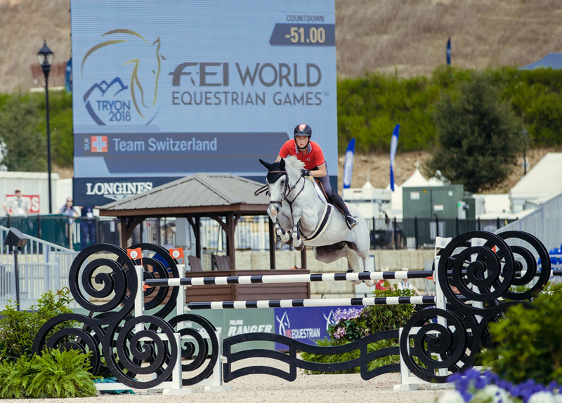 Switzerland's Martin Fuchs and Clooney familiarize themselves with the arena ahead of the Bank of America Jumping Championship which gets underway at the FEI World Equestrian Games™ 2018 in Tryon, USA tomorrow morning (Sept. 19). (FEI/Christophe Taniere)