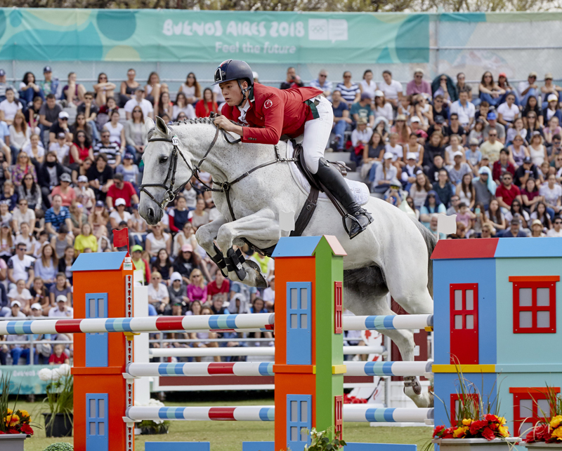 Flying high to victory in a five-way jump-off, Italy's Giacomo Casadei with his mount Darna Z take gold in the Individual jumping final at the Youth Olympic Games Buenos Aires 2018.