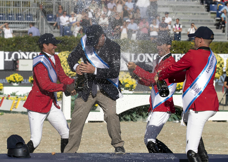 Team Belgium showered their chef d'equipe, Peter Weinberg, in a champagne celebration after winning the Longines FEI Jumping Nations Cup™ 2018 title at Real Club de Polo in Barcelona (ESP).