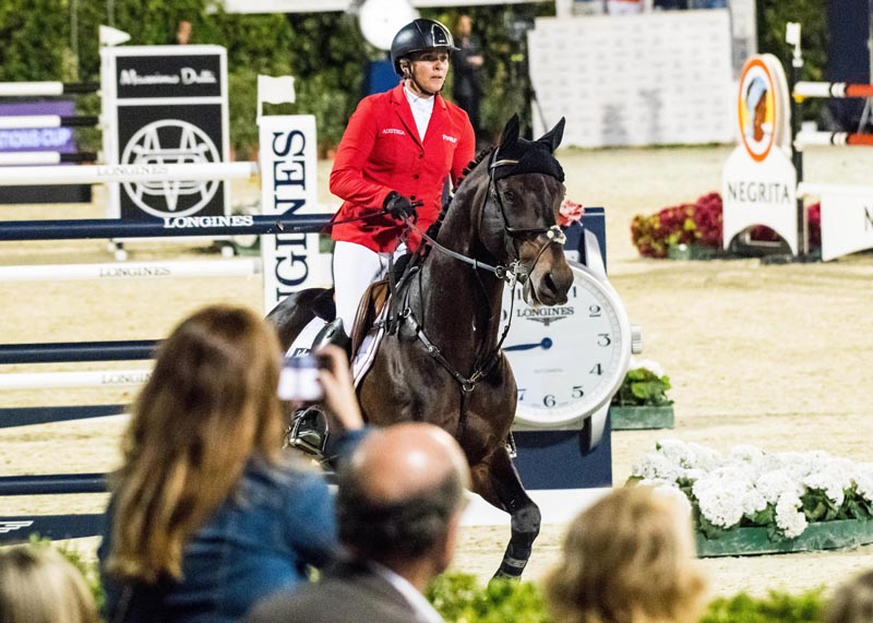 Julia Houtzager-Kayser steered Sterrehof's Cayetano Z to a clear round to help Team Austria to joint top-spot with Italy in the first round of the Longines FEI Jumping Nations Cup™ Final 2018 in Barcelona (ESP).