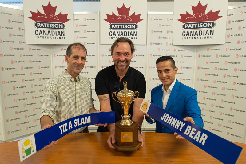 Toronto Maple Leafs alum Darcy Tucker, the guest drawmaster, with jockeys Steven Bahen (left) and Luis Contreras (right) at the post position draw for Saturday's $800,000 Pattison Canadian International (Grade 1), at Woodbine Racetrack. Photo by Michael Burns