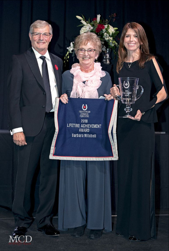 Barbara Mitchell was recognized for her decades of service at the Jump Canada Hall of Fame Induction Ceremony and Gala, presented by BMO Financial Group, on Nov. 4, 2018 at the Liberty Grand in Toronto, ON. She was presented with the 2018 Equestrian Canada (EC) Lifetime Achievement Award by Meg Krueger, EC President, and Craig Collins, EC Director. Photo by Michelle C. Dunn