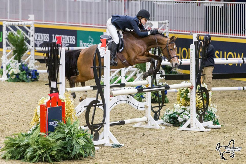 Kilby Brunner Deforest of Hillsburgh, ON, rode Beaverwood's Halo to the win in the $5,000 MarBill Hill Farm Royal Pony Jumper Final on Sunday, November 4. Photo by Ben Radvanyi Photography