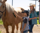 Heartland newcomer Lucian-River Chauhan, on set with star Amber Marshall.Photo by Andrew Bako