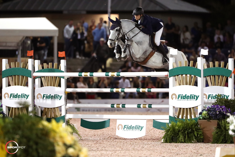Martin Fuchs and Clooney 51 won the $391,000 Fidelity Investments® Grand Prix CSI 5* at WEF. Photo © Sportfot