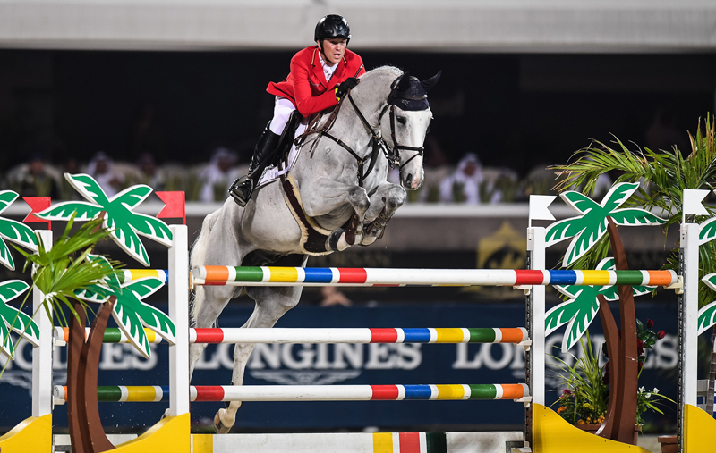 Sven Schlüsselburg and his grey gelding Bud Spencer picked up just a single time fault in both rounds to help Team Germany to victory at today's Longines FEI Jumping Nations Cup™ of the United Arab Emirates in Abu Dhabi (UAE). Photo by FEI/Martin Dokoupil