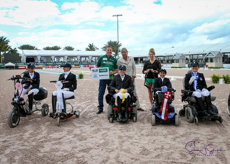 The presentation for the FEI Para Team Test Grade I - CPEDI 3* with Deborah Stanitski, Winona Hartvikson, Jody Schloss, David Botana, Roxanne Trunnell, Allyn Mann of Adequan®, Judge at C, Birgit Valkenborg, and Kathryn Bastarache from Fair Sky Farm. Photo ©SusanStickle.com.