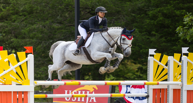 Ava Wong and Concelo competing in the Children's division of the 2018 North American Youth Championships at Old Salem Farm, New York. Photo by Jump Media