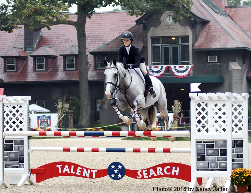 Daisy Farish, seen here against the backdrop of the historic U.S. Equestrian Team Foundation stables, was the winner of the 2018 Platinum Performance/U.S. Equestrian Federation Talent Search Show Jumping Finals East. Photo ©2018 by Nancy Jaffer