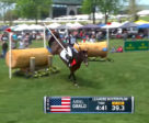Ariel Grald and Leamore Master Plan carried a flag along with them on course at the Land Rover Kentucky Three-Day Event.