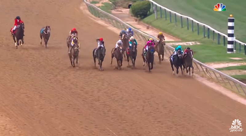 War of Will can be seen taking the lead going into the last stretch in the 2019 Preakness Stakes, as an outrider attempts to catch the riderless Bodexpress.